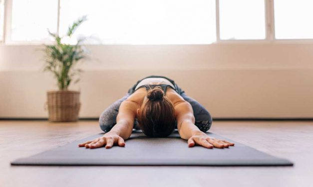 Practicing Yoga to new age music